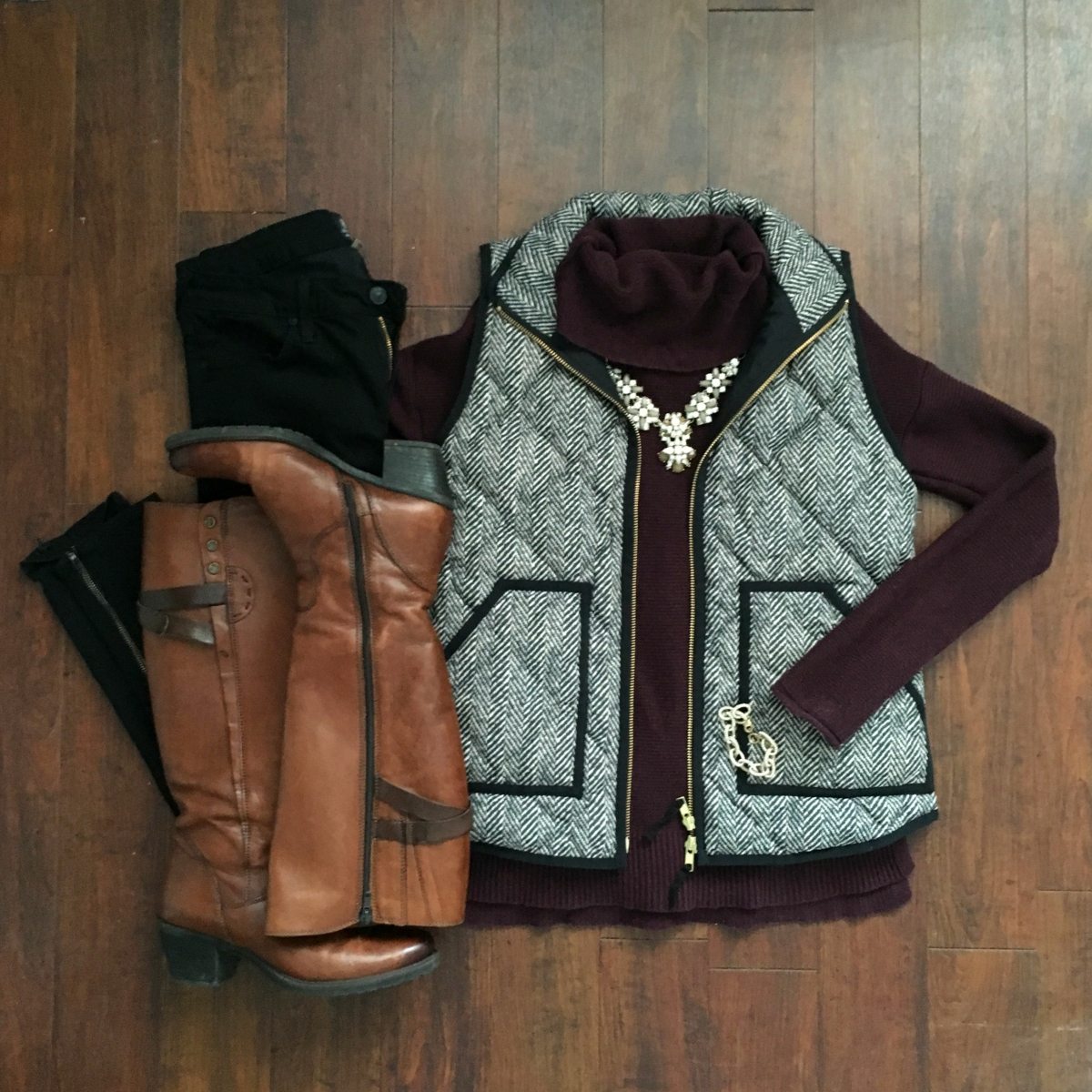 herringbone vest with a plum turtleneck and statement necklace