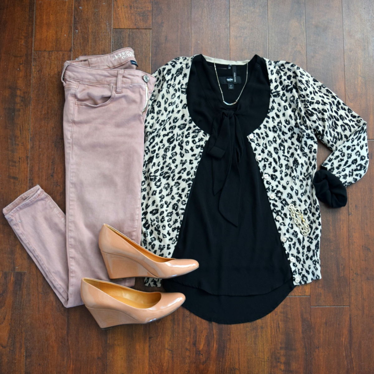 Leopard cardigan, a sheer black blouse, and pink sateen skinny jeans