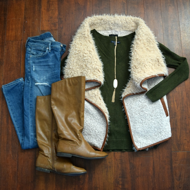 Faux shearling vest, hunter green sweater, destroyed denim, and boots