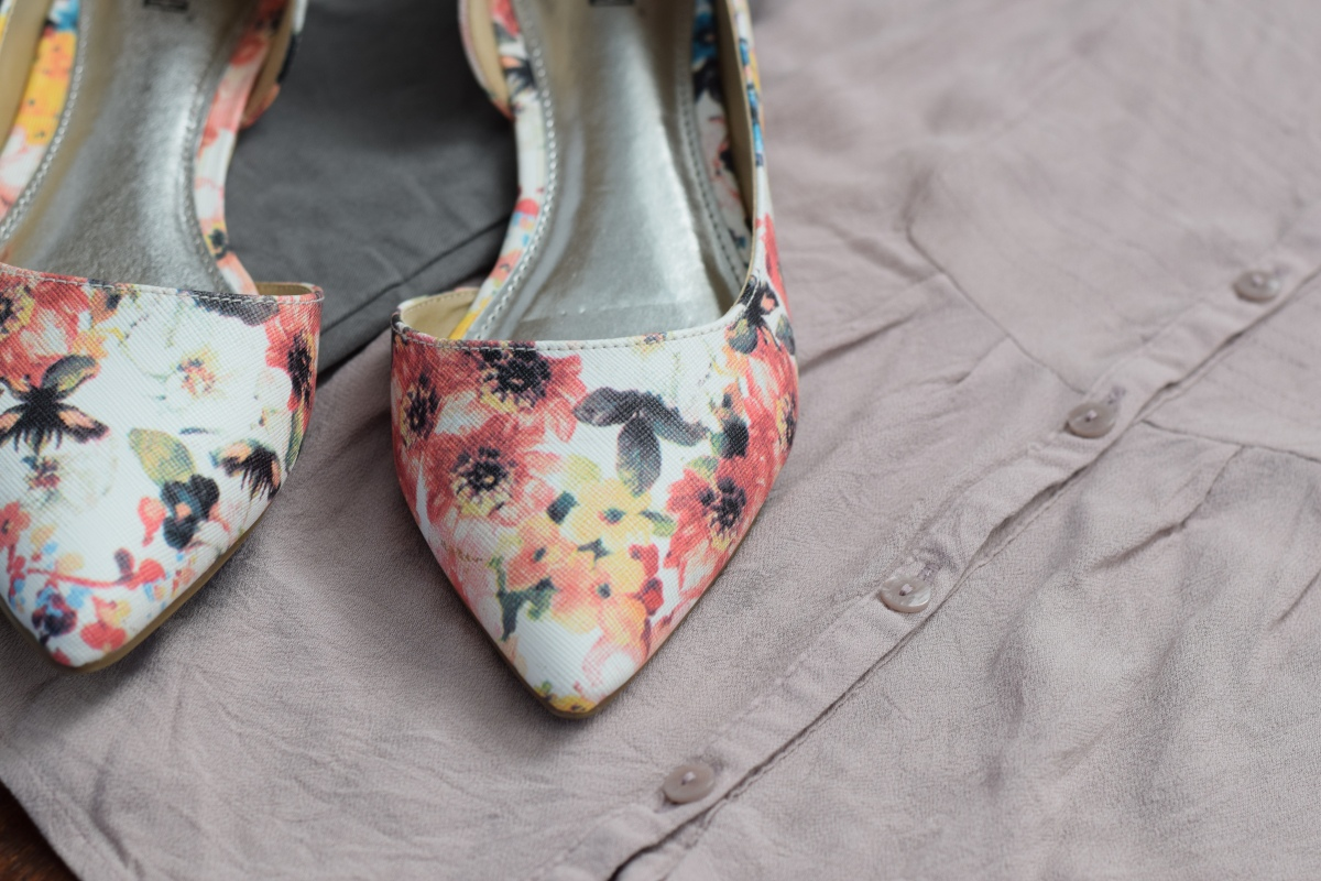 floral flats, a pheasant top, and grey chinos