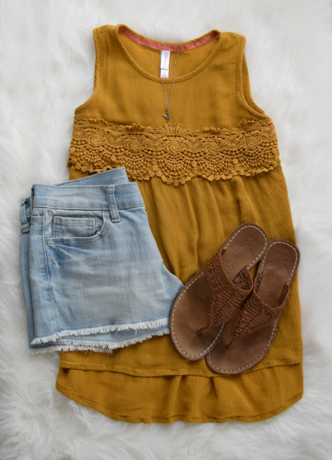 Nothing says summer like a flowy boho top and cutoff shorts |www.pearlsandsportsbras.com|