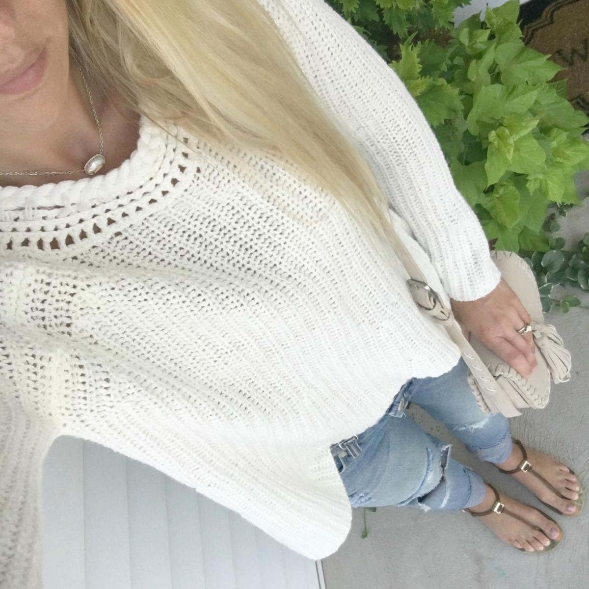 Cozy oversized sweater and destroyed denim |www.pearlsandsportsbras.com|