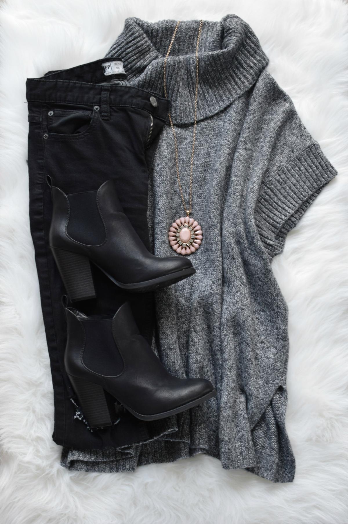 Turtleneck cape sweater, distressed black denim, ankle booties, and pops of blush |www.pearlsandsportsbras.com|