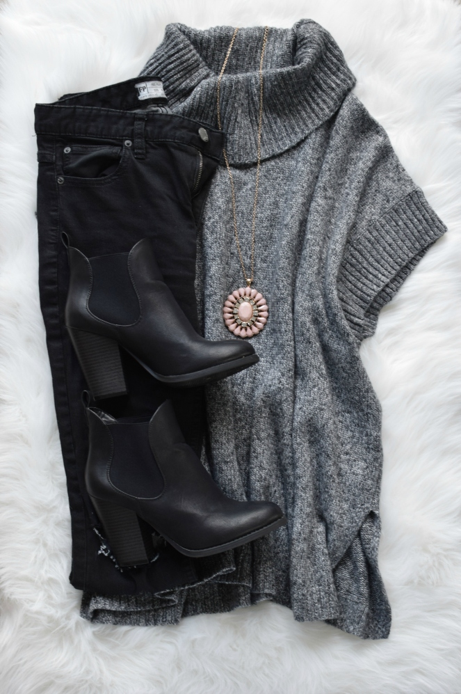 Turtleneck cape sweater, distressed black denim, ankle booties, and pops of blush |www.pearlsandsportsbras.com|